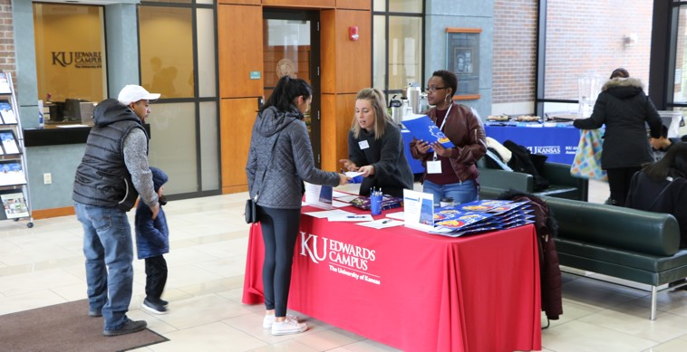 Students and their families check in to attend the College Bound Latinos/Latinx of Kansas event Saturday, Jan. 26 at the KU Edwards Campus.