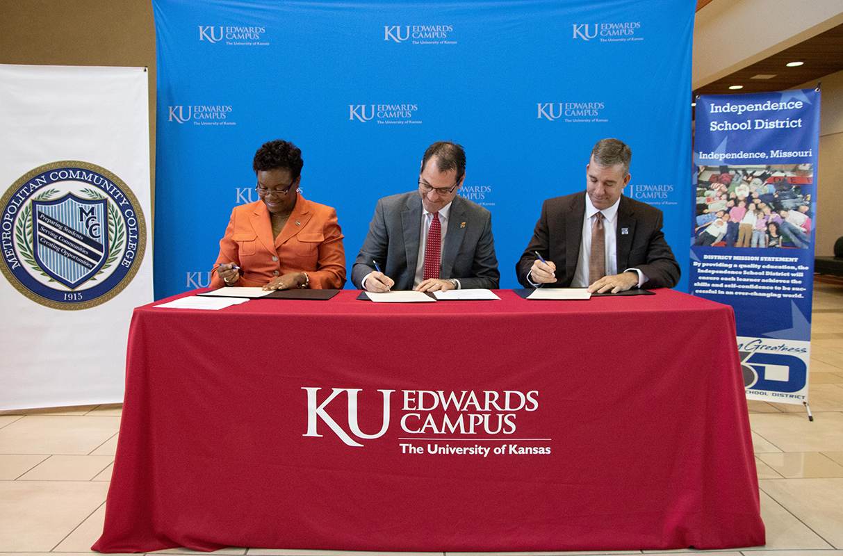 (From left) Metropolitan Community College Chancellor Kimberly Beatty, KUEC Vice Chancellor David Cook and Independence School District (ISD) Superintendent Dale Herl sign a proclamation of intent for a new Degree in 3 partnership on May 6 at the KU Edwards Campus. High school students in ISD will be able to earn a bachelor's degree from KU in only three years.