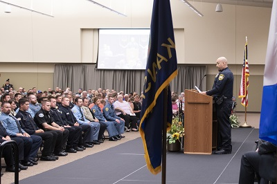 Keith Quesada, class president of the 256th KLETC graduating class, gives remarks at the commencement ceremony July 19.