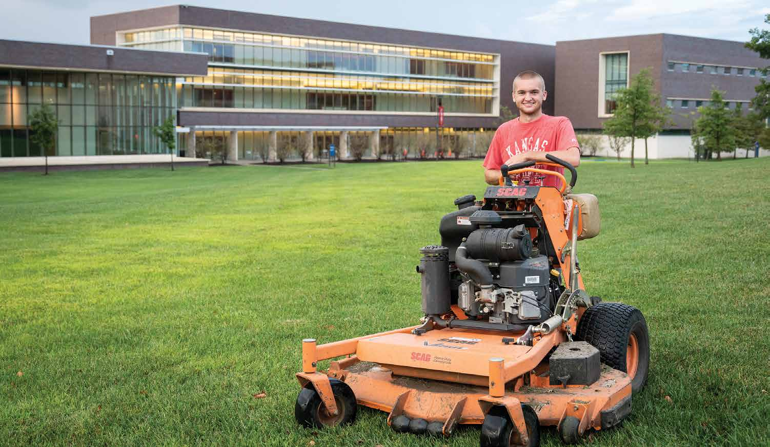 By opting to enroll in Degree in 3, an accelerated degree path at KU Edwards Campus, Eric Fecteau can devote more time to his lawncare business while earning his undergraduate degree. Photo by Steve Puppe.