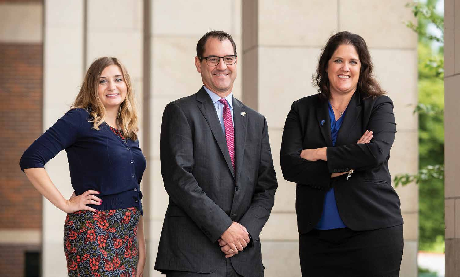 Lauren McEnaney, David Cook and Carolyn McKnight believe the program offers career-oriented students in Kansas City a cost-efficient way to attend KU. Photo by Steve Puppe.