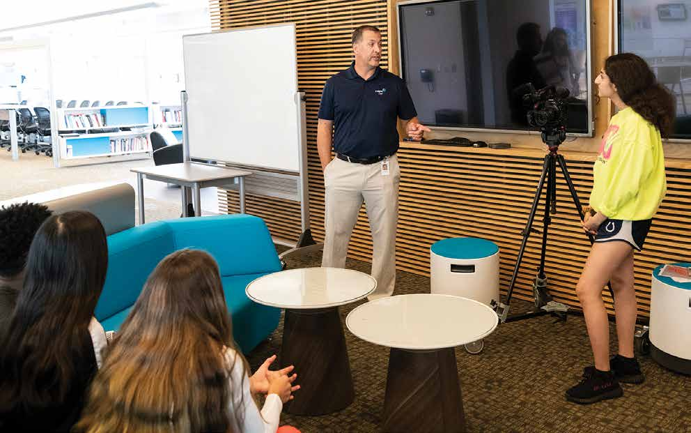 "Chad Ralston, director at Blue Valley CAPS in Overland Park, visits with high school students to create a ""mockumentary"" for a filmmaking class. Photo by Steve Puppe."